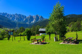 Picnic tables with mountain view — Stock Photo