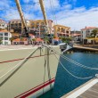 Yacht boat moored in marina wooden pier colorful houses, Madeira island, Portugal — Stock Photo