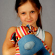 Little girl with a toy dog — Stock Photo #24689843