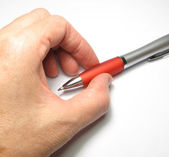 Women's arm with a ballpoint pen. — Stock Photo