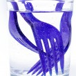 Disposable forks in glass of water — Stock Photo #12794295