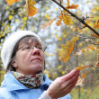 Autumn in nature, contemplate middle-aged woman — Stock Photo #12802307
