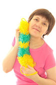 Middle-aged women with colored synthetic sponge for washing the — Stock Photo