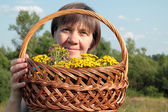 Age Woman with wildflowers — Stock Photo