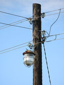 Lamp on a wooden pole and wires — Stock Photo