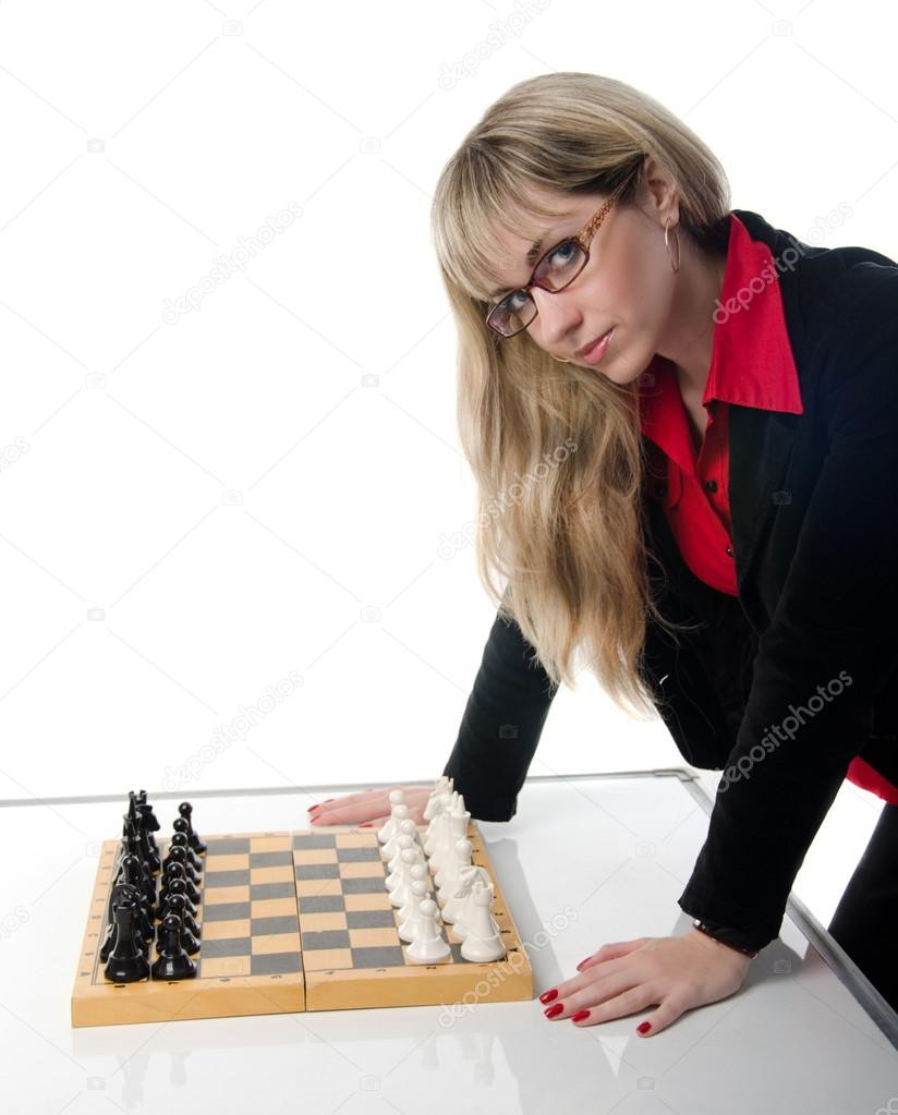 Beautiful businesswoman invites to play chess — Stock Photo #12123212