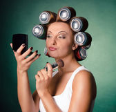 Girl with cans in hair — Stock Photo