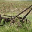 Antique Plow abandoned in a field — Stock Photo