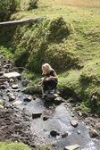 Young Girl by a Stream — Stock Photo