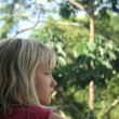 Stock Photo: Young Girl Looking at Jungle
