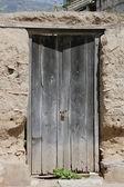 Gray Weathered Wooden Door — Stock Photo