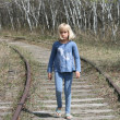 Young Blond Girl on Railway Tracks — Stock Photo #26091305