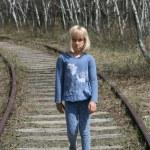 Young Girl Walking Along Railway Tracks — Stock Photo #26091743