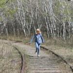 Young Girl Running Along Abandoned Railway Tracks — Stock Photo #26091881