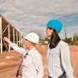 Two engineers at construction site — Stock Photo #12541913