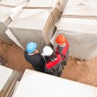 Director with subordinates on construction site — Stock Photo #12541915