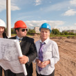 Stock Photo: Director with subordinates on construction site