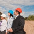 Stock Photo: Director with subordinates on construction site of shopping cent