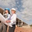 Two engineers at construction site — Stock Photo #12541932