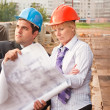 Director with subordinate on construction site — Stock Photo