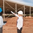 Two engineers at construction site — Stock Photo #12541956