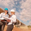 Two engineers at construction site — Stock Photo #12541960