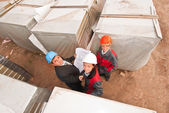 Group of engineers at construction site — Stock Photo