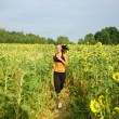 Morning jogging on sunflower field — Stock Photo