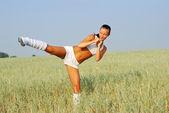 Young woman exercising — Stock Photo