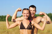 Happy young couple doing morning sports exercises — Stock Photo