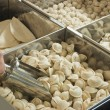 Buying frozen dumplings — Stockfoto