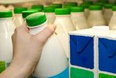 Buying milk — Stock Photo