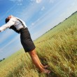 Attractive happy young woman in the field — Stock Photo #12684795