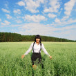 Attractive happy young woman in the field — Stock Photo #12684810