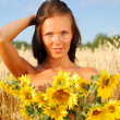 Stock Photo: Young womwith sunflowers