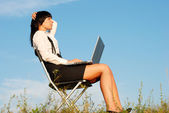 Business woman outdoor in sunset light — Stock Photo