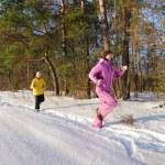 Family winter jogging — Stock Photo