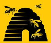 Icono de la colmena y las abejas — Vector de stock