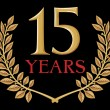 Stockvector : Golden laurel wreath 15 years