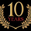 Stockvector : Golden laurel wreath 10 years