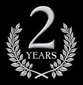 Golden laurel wreath 2 years — Stockvector