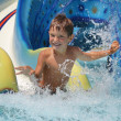 Outdoor portrait of young smiling child having fun in aquapark — Stock Photo