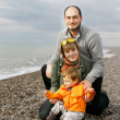 Young happy family on beach — Stock Photo #12605118