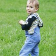Cute baby boy on grass background — Stock Photo