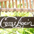 Come again phrase on wooden board — Stock Photo #12605487