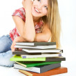 Attractive student girl with pile of books over white — Stock Photo