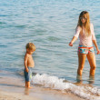 Mother and son on beach - Stock Photo