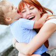 Happy mother and son on natural background — Stock Photo