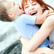 Happy mother and son on sea background — Stock Photo #12608107