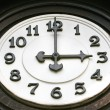 Old wooden clock face - Stock Photo